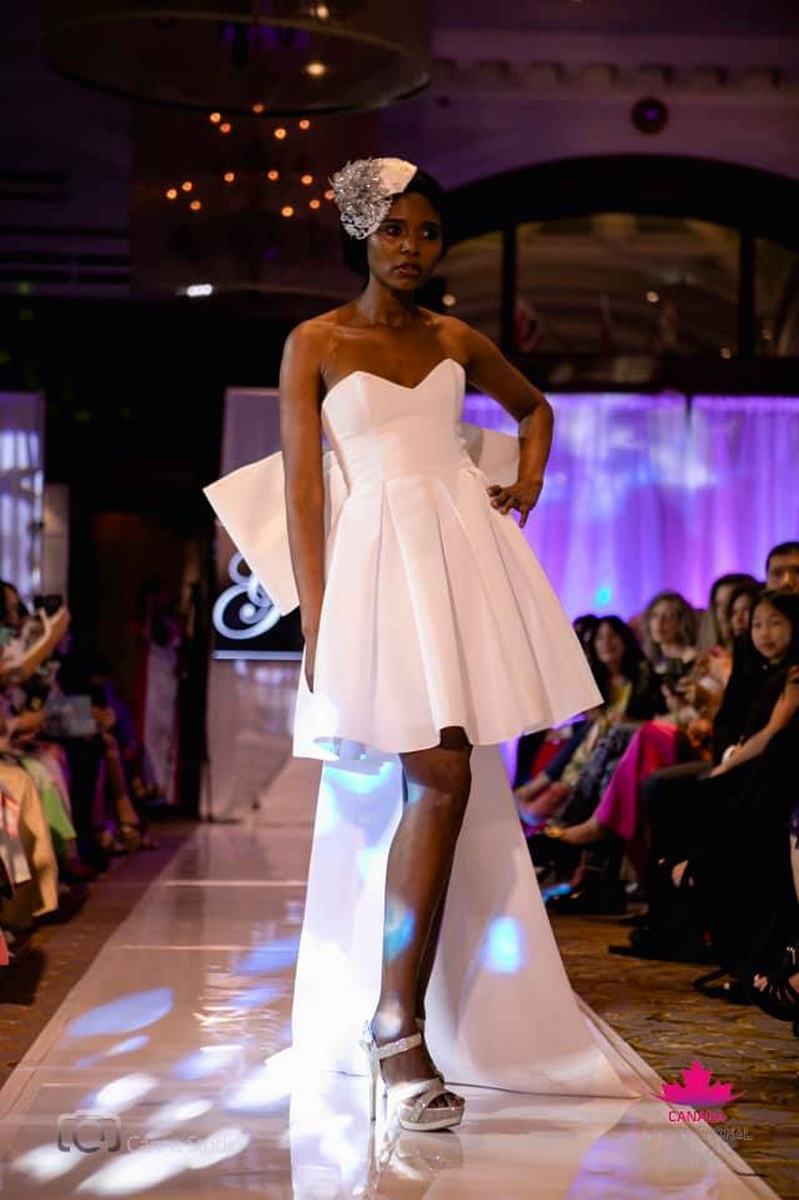 A mini dress with large bow by Gundula Couture.