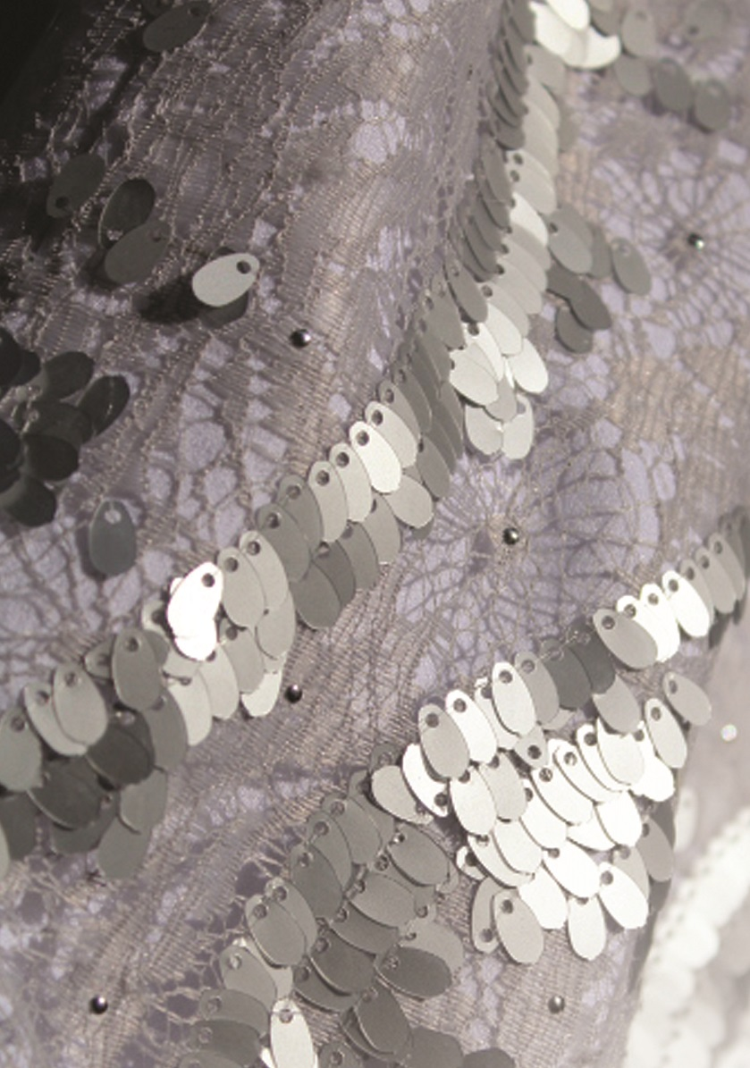 An image of a silver sequined fabric used on a garment created by Gundula Hirn of Gundula Couture.